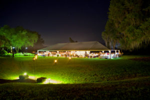 wedding reception under tent at night